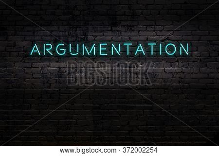 Neon Sign On Brick Wall At Night. Inscription Argumentation