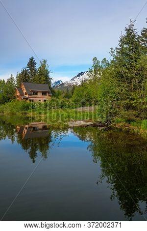 A Tranquil Morning Scene On Bear Lake Near Seward Alaska.