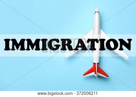 Toy Plane On Light Blue Background, Top View. Immigration Concept