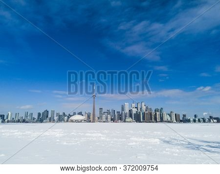 Toronto City Skyline Seen From Toronto Islands Over Frozen Lake Ontario