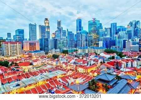 Aerial View Of The Evening Cityscape Of Singapore Chinatown With Downtown Skyscrapers Of The Busines