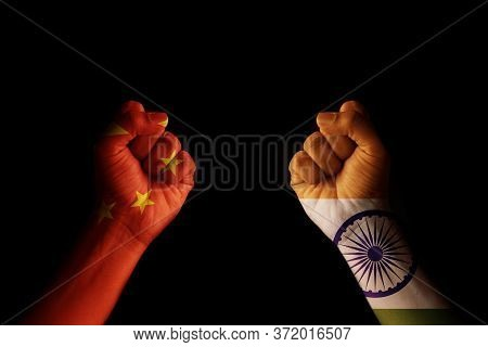 Concept Of Dispute Or Conflict Between India And China Showing With Fist Hands.