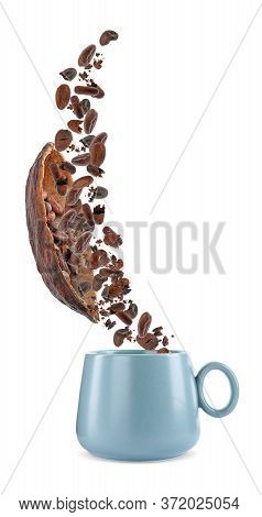Cocoa Pod And Beans Falling Into Cup On White Background