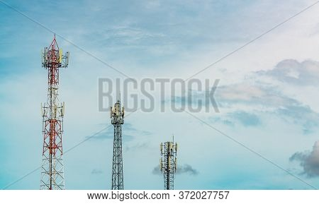 Telecommunication Tower With Blue Sky And White Clouds. Antenna On Blue Sky. Radio And Satellite Pol