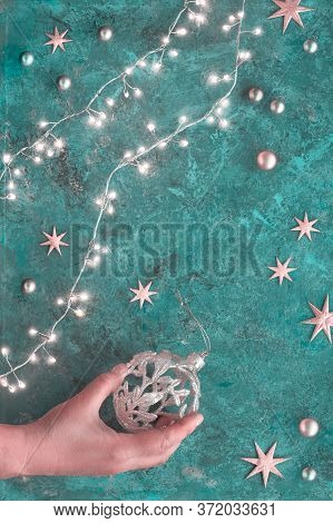 Christmas Or New Year Flat Lay Background On Dark Turquoise Background. Top View Flat Lay On Xmas Ga
