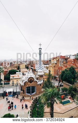 Barcelona, Spain - 15 December 2019: Park Guell Is A Public Park Composed Of Gardens, Mosaics And Ar