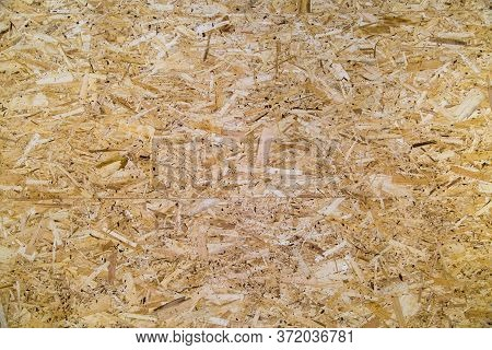 Background Of Osb Plate With A Spike-groove Pattern Of Planed Wood In Yellow.  Design Backgrounds Te
