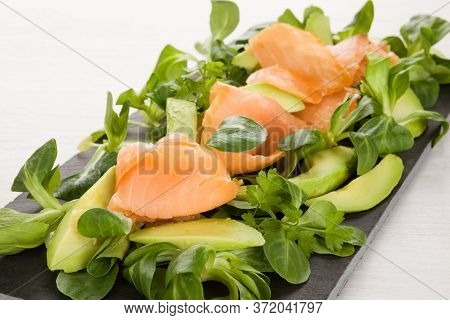 Omega Fatty Acids. Salmon, Avocado And Salad. Healthy Eating.