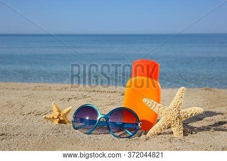 Summer Women's Accessories On The Beach Sea.