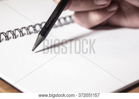 Extremly Close-up Of Man Hand With Pen Writing On Notebook. Education Concept.