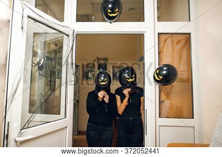 Atmosphere Of Halloween With Black Scary Baloon