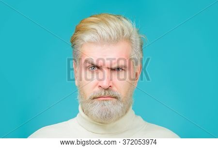 Barbershop Concept. Man With Bleached Hair And Beard. Coloring Of Men's Hair. Bearded Man With Dyed