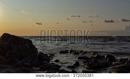 Baltic Sea Rocky Beach At Sunset Time