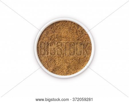 Heap Of Coconut Sugar Isolated On White Background. Top View. Heap Of Coconut Sugar On White. Dark S