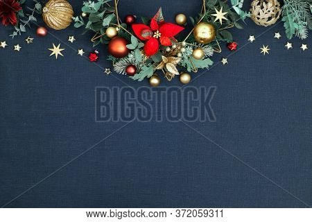 Decorative Christmas Border, Floral Garland With Eucalyptus, Baubles, Trinkets And Red Poinsettia. R