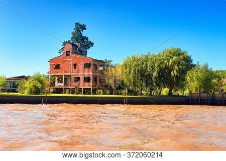 Tigra Delta In Argentina, River System Of The Parana Delta. Lush Vegetation, Palm Trees, Constructio