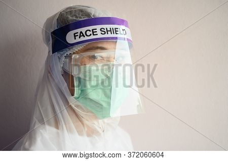 Nurse Wearing Ppe Suit, Face Shield And Surgical Mask For Protect Coronavirus Disease. Ppe While Pro