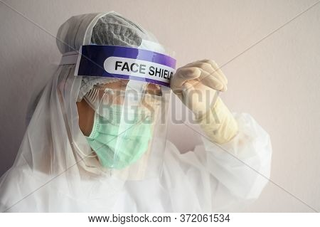 Nurse Having Headache And Tired While Wearing Ppe Suit For Protect Coronavirus Disease. Ppe While Pr