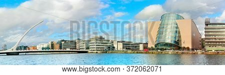Trendy Dublin Riverside. Panoramic Image Of Convention Centre And Samuel Beckett Bridge Over The Riv