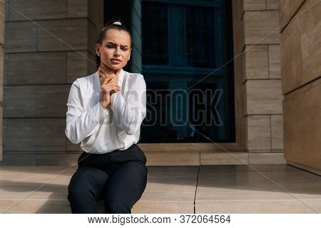 Beautiful Girl Holds Her Hands By The Throat. Sore Throat During The Virus. Advertising Throat Remed