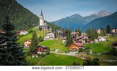 Typical Swiss Village In A Valley Of The Swiss Alps In Switzerland - Travel Photography