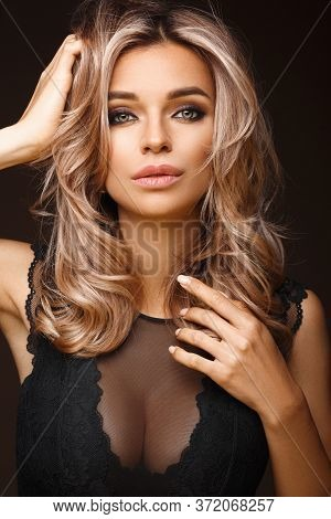 Beautiful Attractive Woman In Underwear Poses In A Photo Studio