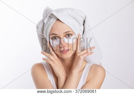 Eye Patches for Brighter, Younger-Looking Eyes, Anti-aging treatment, girl with towel on head