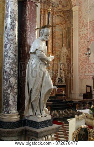 ZAGREB, CROATIA - MAY 16, 2013: St. Francis Regis, statue on the altar of St. Ignatius of Loyola in the Church of Saint Catherine of Alexandria in Zagreb, Croatia