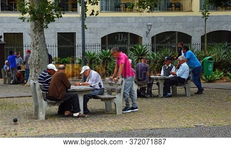Funchal, Madeira, Portugal - June 29, 20019: Older Men Socialising And Playing Games In Funchal Made