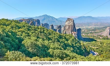 Panoramic view of forest and rocks in Meteora in Greece with ancient Rousanou nunnery - Colorful greek landscape
