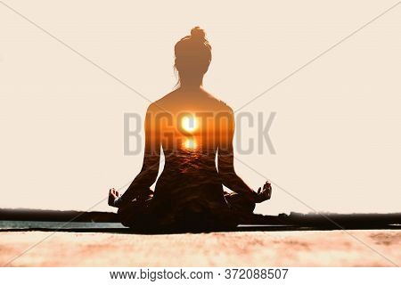 Yoga Day Concept. Multiple Exposure Image. Woman Practicing Yoga At Sunset.