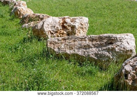 Large Boulders Of Jurassic Limestone Lying In A Meadow In Swabian Alb