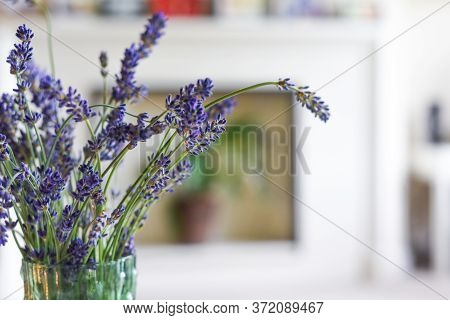 Modern Home Interior Of Living Room With Scented Candle And Lavender Flowers On Coffee Table