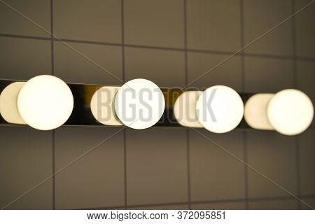 White Candelabra Globe Bathroom Bulbs Above Mirror.