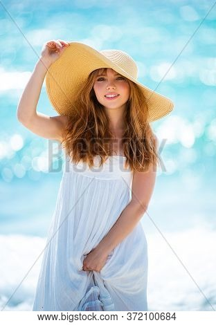 Happy Girl Feels Happy On Sea. Portrait Of Happy Girl With Beauty Face Smiling Looking At Camera. Be