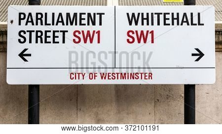 London, UK - 5th June 2017: Iconic City of Westminster road sign giving directions to Parliament Street and Whitehall, SW1. This is the centre of UK Government in the City of London.