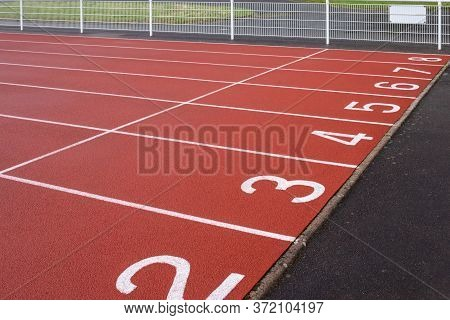 The Numbers At Start Point Of Running Track Or Athlete Track In Stadium, Running Court, Red Syntheti