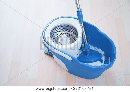 Floor Cleaning With Mob And Bucket. Cleaning Floor In The Room.