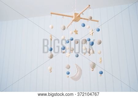 Baby Crib Mobile. Toys Above The Baby Crib. Hanging Soft Balls For The Child.