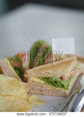 Breakfast Sandwich Howe Bread Stuffed With Ham And Lettuce Salad Vegetable Potato Chips, White Flag