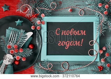 Happy New Year Text In Russian Language. Flat Lay With Xmas Decorations In Green And Red With Froste
