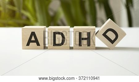 Adhd Text On A Wooden Building Blocks On Grey Background. Attention Deficit Hyperactivity Disorder A
