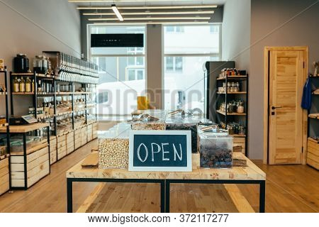 Zero Waste Shop Interior. Wooden Counters And Shelves With Different Food Goods And Personal Hygiene