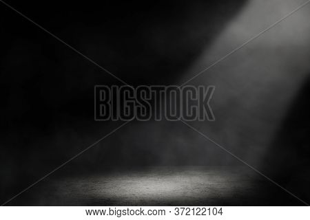 Empty Space Of Studio Dark Room With Spot Lighting And Fog In Black Background.