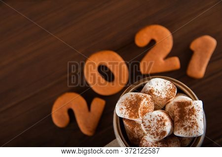 Concept With Marshmallows In A Mug And Gingerbread Cookie On A Dark Background. Christmas, Coffee, T