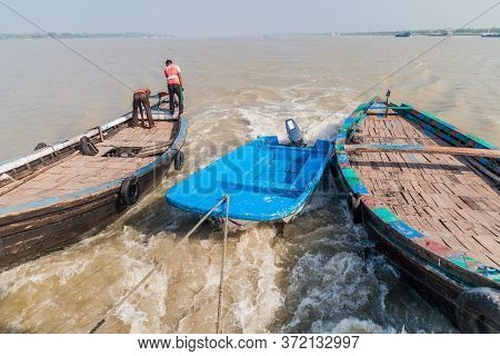 Rupsa, Bangladesh - November 13, 2016: Small Boats Towed By M. V. Dinghy Ship Of The Bengal Tours Lt