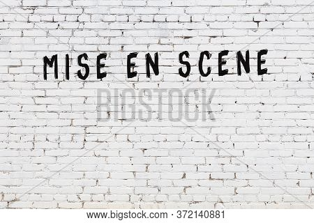Word Mise En Scene Written With Black Paint On White Brick Wall.
