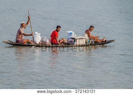 Rupsa, Bangladesh - November 15, 2016: Three Men On A Small Conoe On Rupsa River, Bangladesh