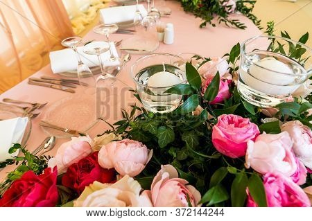 Flowers On The Table With Serving And Table Setting For A Reception Before A Large Reception