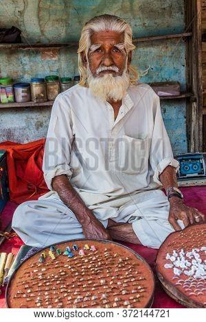 Bagerhat, Bangladesh - November 16, 2016: Old Jewellery Seller In Bagerhat, Bangladesh